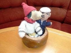 "Pet Officer Snoopy and Jolly Wodger making friends in the dog bowl carved from the timbers of the historic Falklands wreck of the ""Vicar of Bray"""