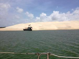 Passing the unbelievable sand dunes of Ilha Dos Lencois on the way to the anchorage