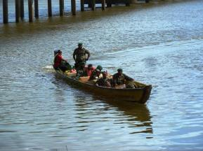 The ferry was broken so those with an urgent need to cross the river were ferried by pirogue instead