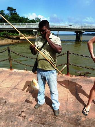 This guy whiled away the time waiting for the ferry repair by catching piranha with a bamboo rod, a single hook and bread as bait