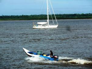 Mina2 at anchor in the Essequibo River, Guyana