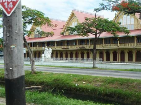 An old government builing in Georgetown (the capital of Guyana) with a statue of Queen Victoria outside (her nose had been knocked off)