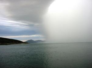 A spectacular rain storm sweeps down the fjord