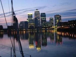 Passing Canary Wharf in the Thames as we leave at dawn on our first adventure